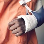 Personal Injury photo of broken arm in sling and cast