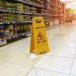 Slip & Fall photo of wet floor with caution sign