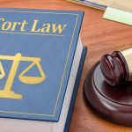Tort law with gavel in courtroom photo